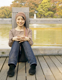asian woman by water