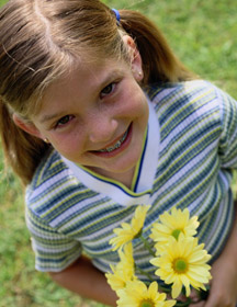 child with yellow flowers